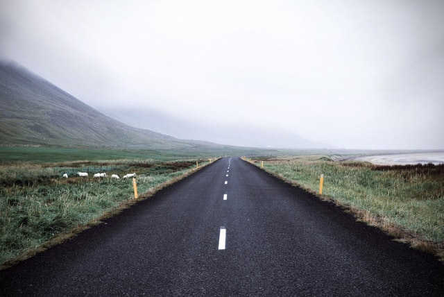 A picture of a long and empty country road.