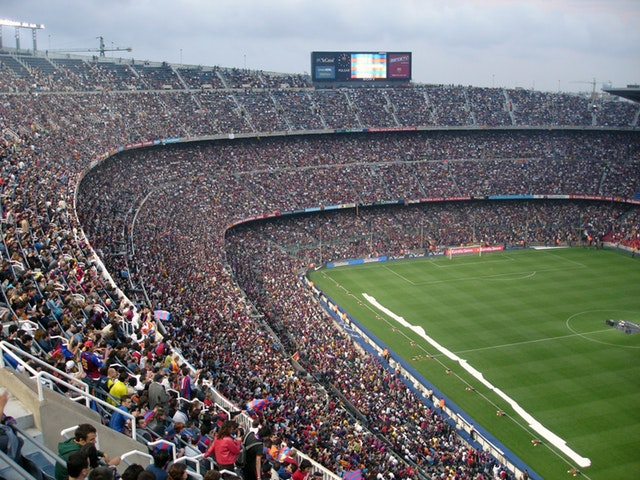 A large stadium with thousands of people as a metaphor for choosing the target audience for a technology blog post.